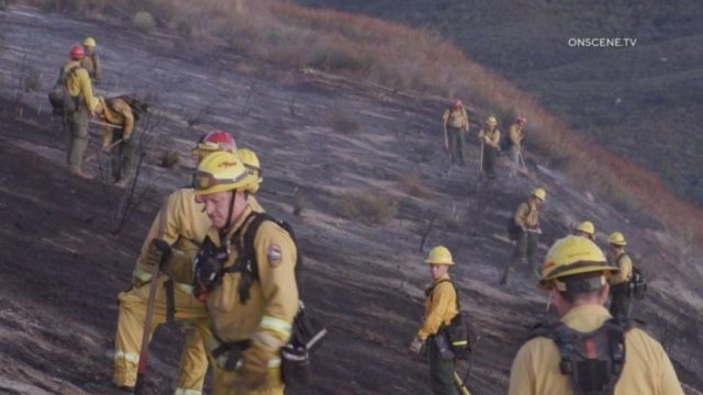 U.S. Forest Service personnel fight the brush fire