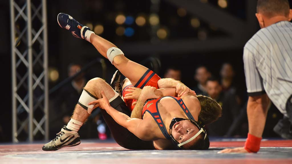 Fresno State's Jeremy Trinh looks up against Army's Trey Chalifoux in opening 125-pound match won by Chalifoux in a fall.