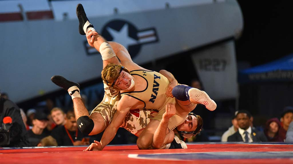 Wisconsin's Tristan Moran handles Navy's Cody Trybus in a 141-pound match won by the Badger.