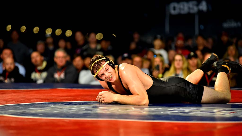 Army's Noah Stewart was slow to get up after being slammed to mat in 184-pound match.