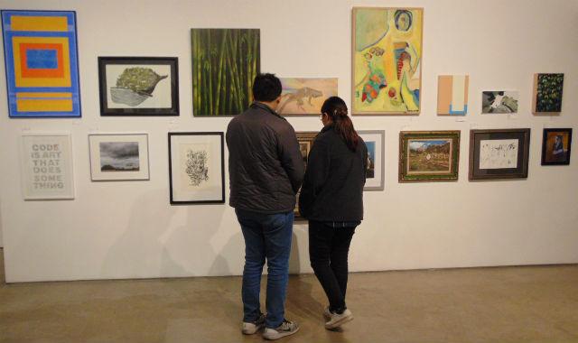 Couple examining art