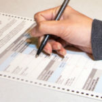 A voter fills out a California ballot