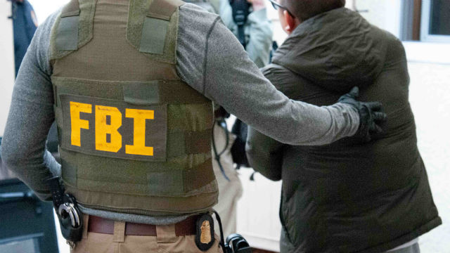 FBI agent arrests a suspect