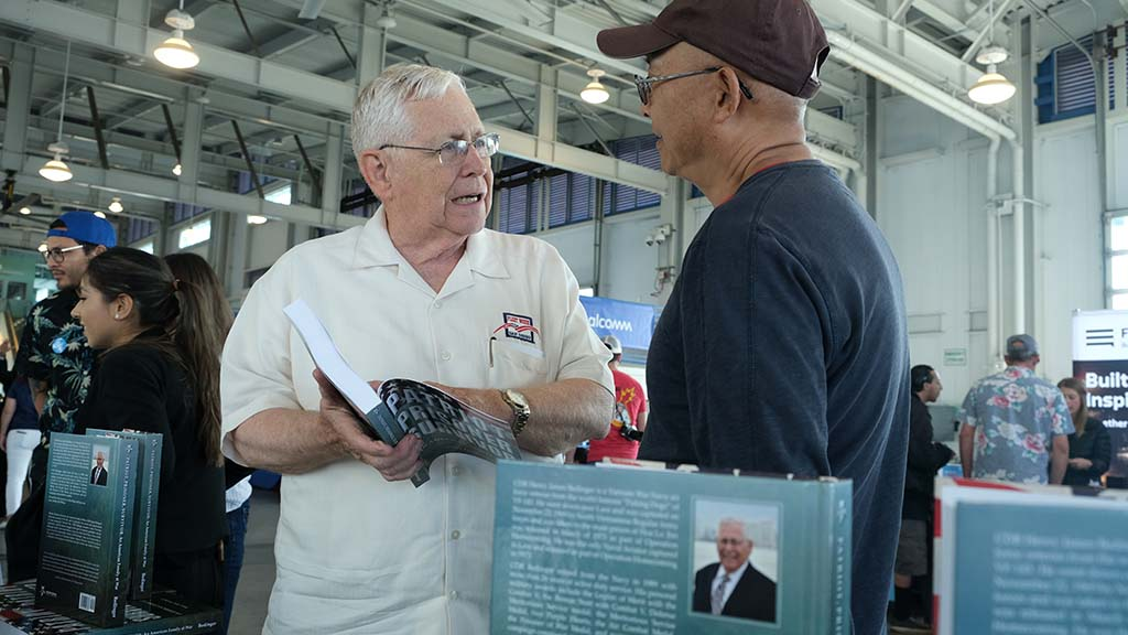 Ret. Cmdr. Henry James Bedinger spoke with a visitor about his book about his family's military history and his POW experience.