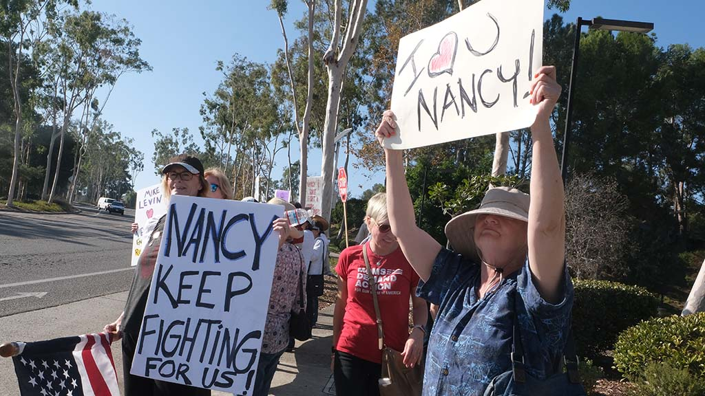 Supporters of Speaker Nancy Pelosi wait in Oceanside to greet her at the QLN Conference Center.