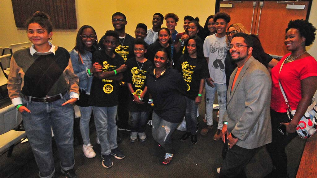 Some of the 25 student members of North County NAACP Youth assemble after Nancy Pelosi appearance in Oceanside.