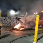 Firefighters use heavy equipment to douse fire