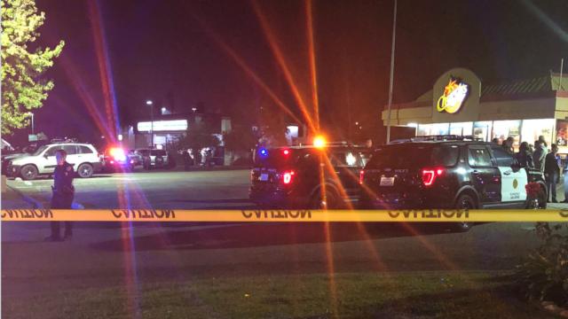 Police investigate shooting scene.