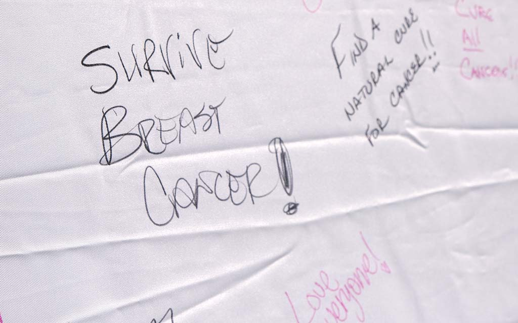 Walkers scrawled hopeful messages at the Susan G. Komen 3-Day Walk closing ceremonies in San Diego.