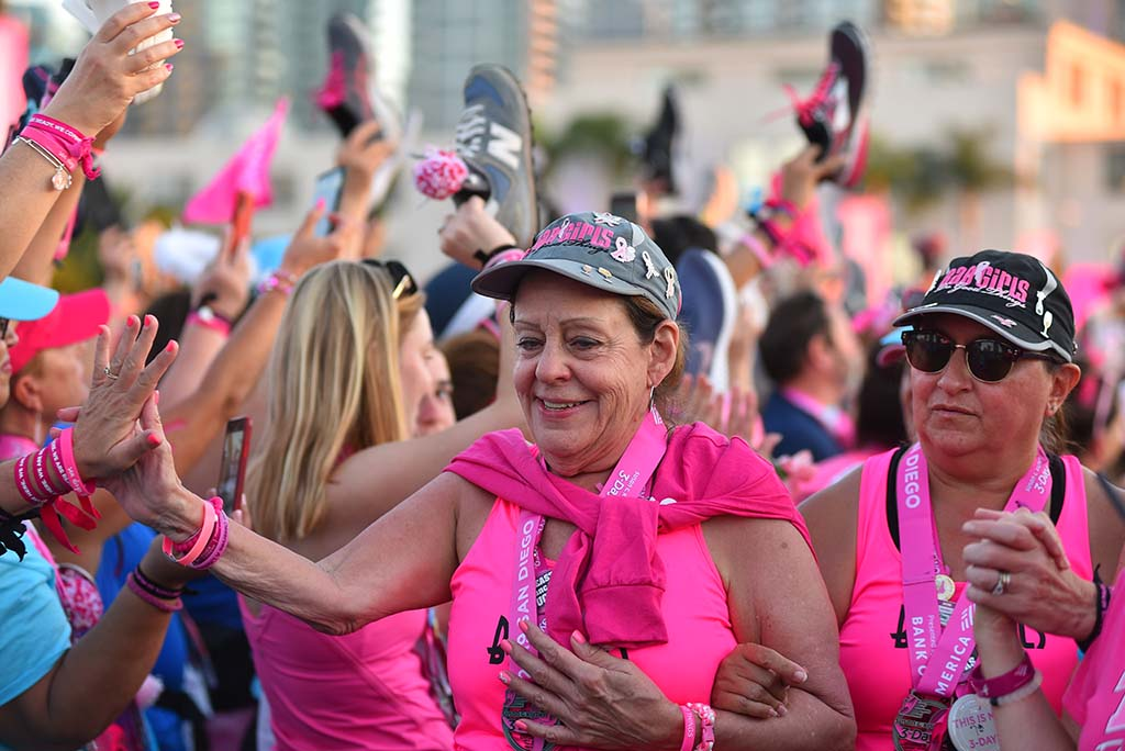Breast cancer survivors are cheered by fellow walkers at the closing ceremony at Waterfront Park.