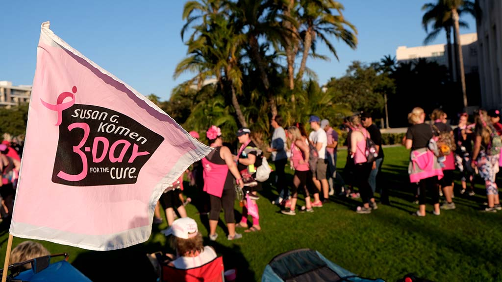 Finishers line up to receive their Susan G. Komen medals before closing ceremonies.