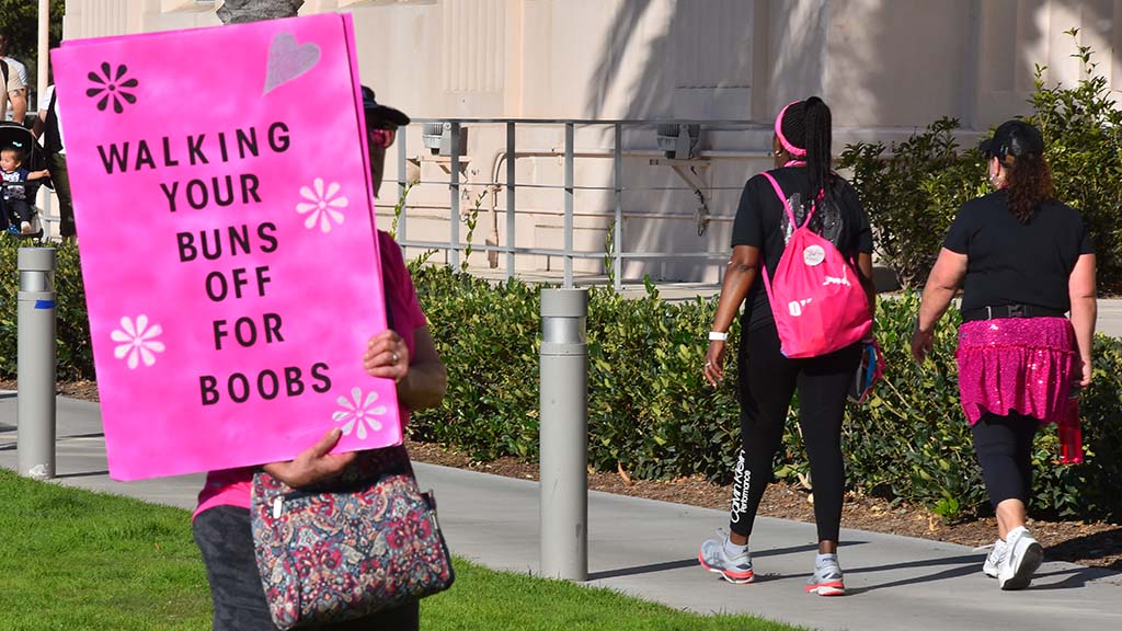 A supporter welcomes walkers of the Susan G. Komen Breast Cancer 3-Day Walk at Waterfront Park in San Diego