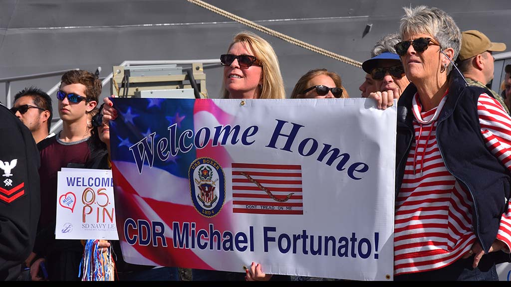 Cmdr. Michael Fortunato is welcomed home Wednesday after a seven-month deployment ends.