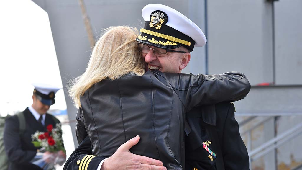 Sailors and Marines aboard the USS Boxer are greeted with long hugs at Naval Base San Diego just in time for Thanksgiving.