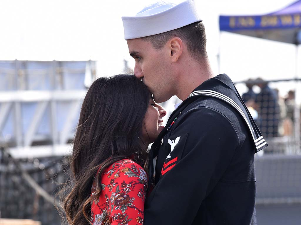 AS2 Chad Crist from Medford, Oregon has a quiet moment with his girlfriend, Marissa Torres of Madera after the USS Boxer returns home to San Diego