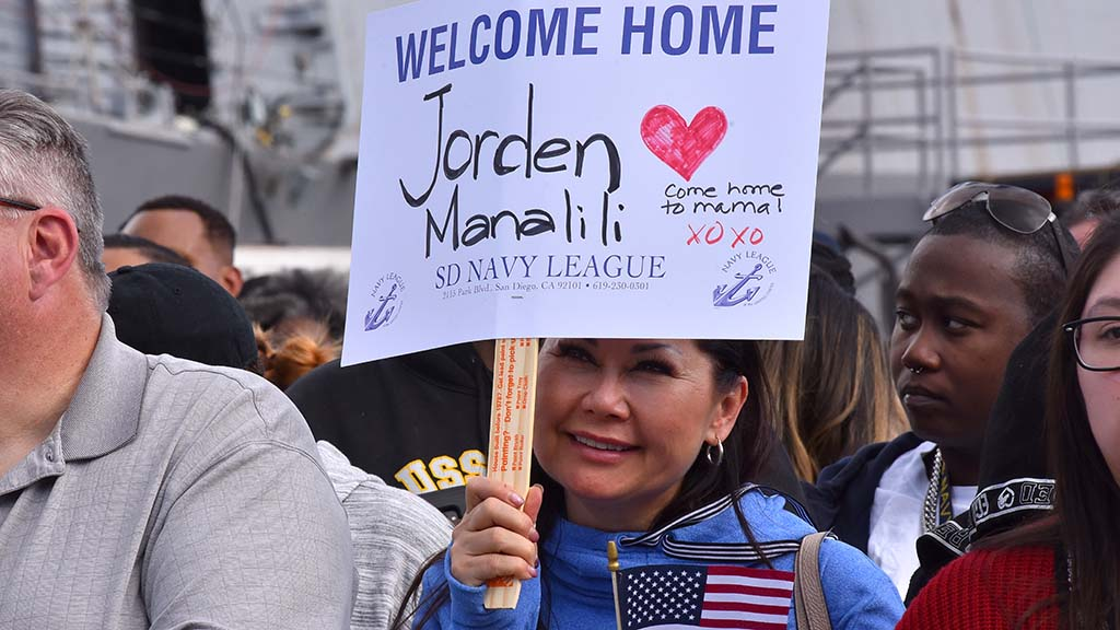 Jorden Manalili, a sailor aboard the USS Boxer is greeted by his mother.