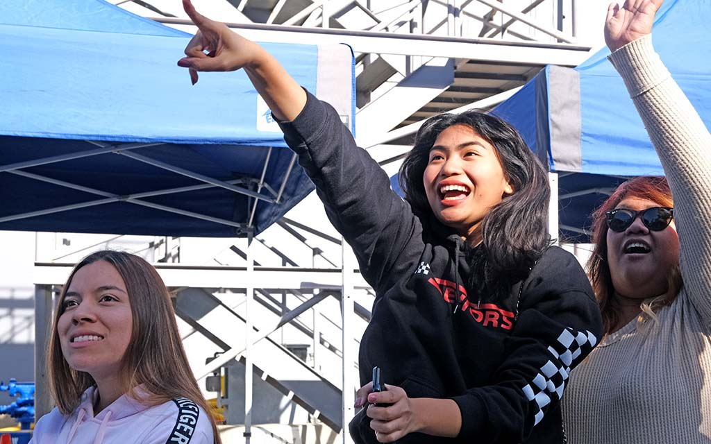 Heidi Ranada of Brea (center) spots her brother, Hecer, as he returns from deployment at Naval Base San Diego.