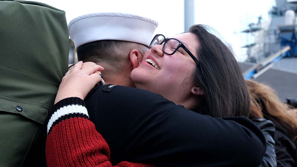 Ariana Farillas hugs her father, Albert, as he returns home in time for Thanksgiving.