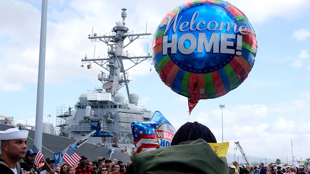 Sailors and Marines were met with welcome home balloons and flowers after a seven-month deployment that included the Middle East.