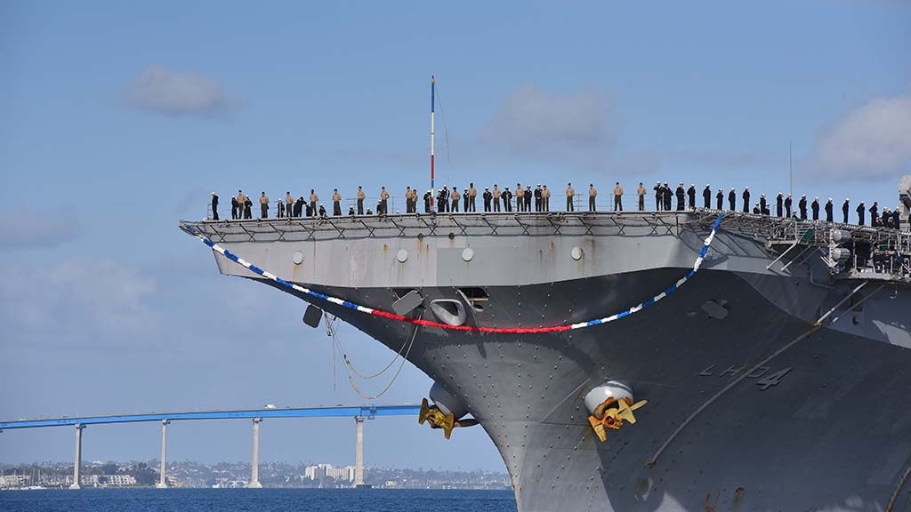 The USS Boxer sails through San Diego Bay to the waiting arms of family and friends the day before Thanksgiving