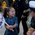 Evelina Flores, 4, shows the welcome home sign she made for her mother, Brenda Flores at Naval Base San Diego.
