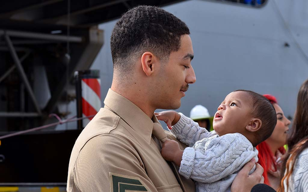 Five-month-old Aries Theo Griham for the first time lays eyes on his dad , Marine Cpl. Avery Tyler Griham, who returned from seven-month deployment.