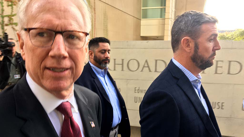 Former county District Attorney Paul Pfingst (left) walks with his client Rep. Duncan Hunter outside downtown federal court.