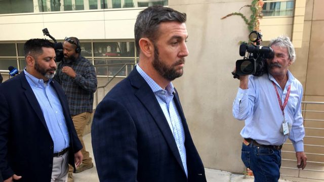 Sporting a new beard, Rep. Duncan D. Hunter walks west on Broadway after his 5-minute court hearing.