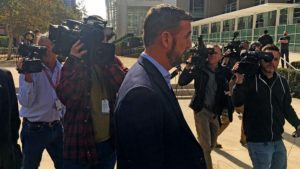 Camera crews follow Rep. Duncan D. Hunter after leaving a court hearing in which the judge's decision on keeping trial lawyer Paul Pfingst was delayed.