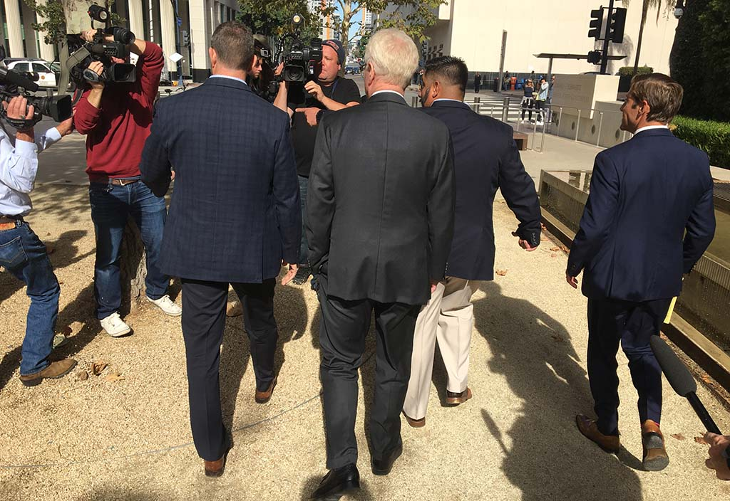 Trial lawyer Paul Pfingst (center) and attorney Devin Burstein (right) walk with their client Rep. Duncan Hunter outside downtown federal court.