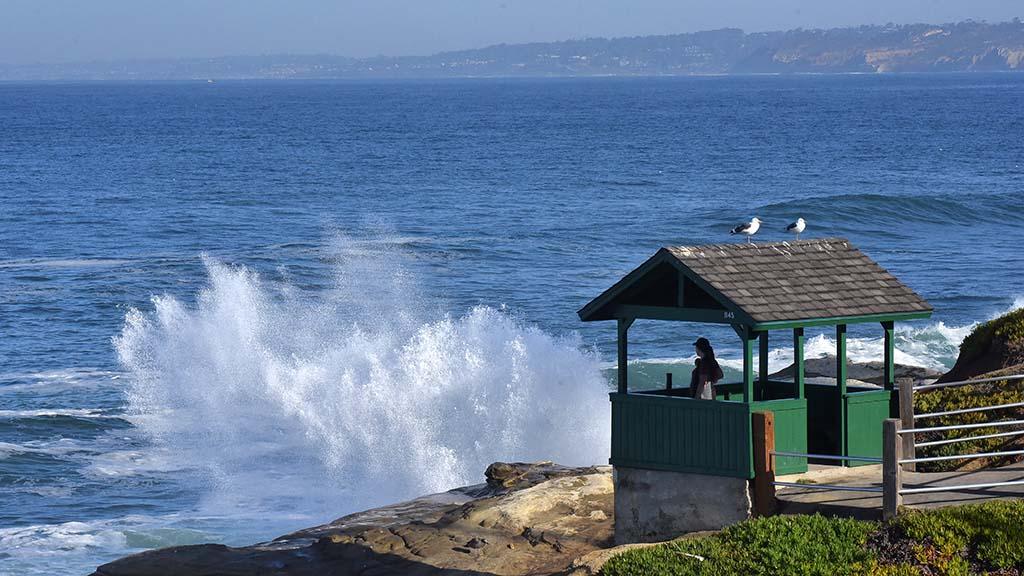 Sea water shoots into the air along the La Jolla shore at high tide during king tides.
