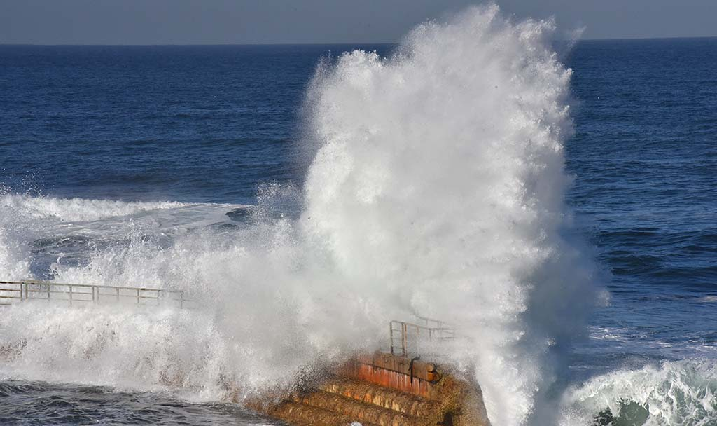 7.2-foot high king tides slam into the sea wall at the Children's Pool in La Jolla.