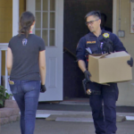 Chula Vista police carry boxes of product out of illegal Broadway marijuana clinic.