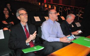 Kevin Beiser sits with fellow San Diego school trustees John Lee Evans (left) and Michael McQuary (right) at State of District event.