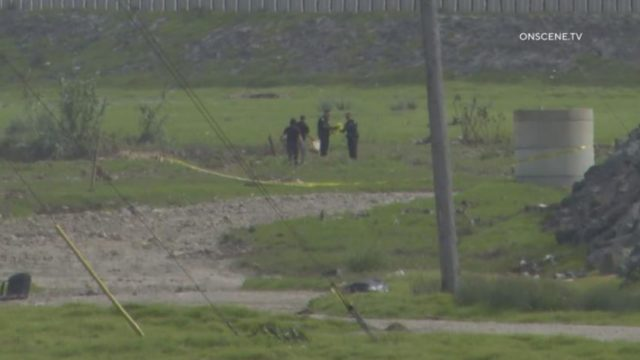 Authorities at site where body was found