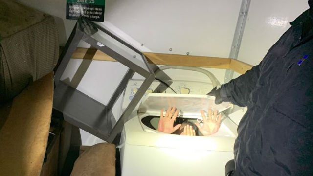Migrants hidden in washing machine surrender