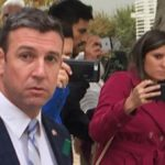Rep. Duncan D. Hunter walks from court hearing.