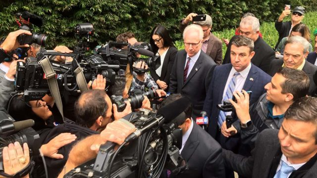 Rep. Duncan D. Hunter walks from court hearing flanked by his lawyer Paul Pfingst (left) and his father, former Rep. Duncan L. Hunter. Photo by Ken Stone