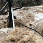 Large water flows into Lake Mendocino from a storm
