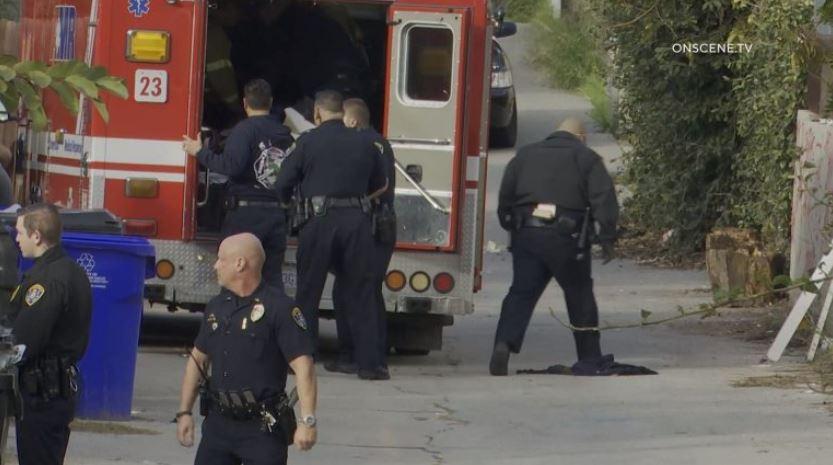 警察の特定人が殺害された。 希望の撮影としてのダリToliver