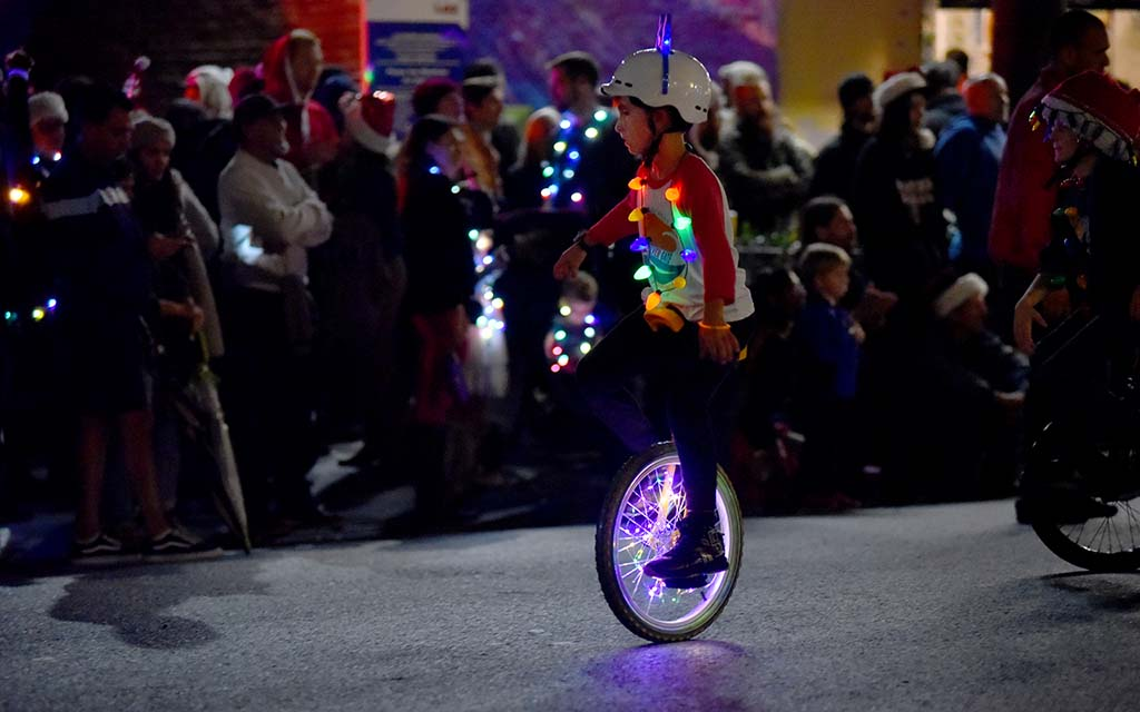 Children on unicycles were light up with holiday lights on the parade route.