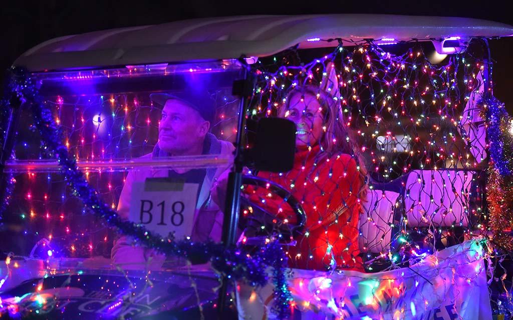 Holiday lights decorate a golf cart down Newport Avenue in Ocean Beach.