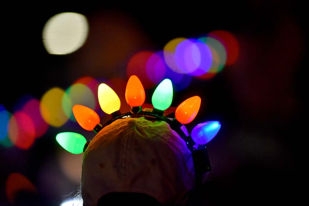 Holiday lights on people and parade participants lit up the night in Ocean Beach.