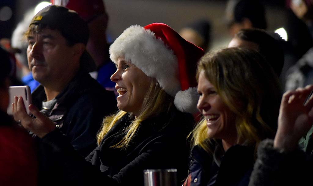 Family and friends cheered participants in the Ocean Beach Holiday parade.