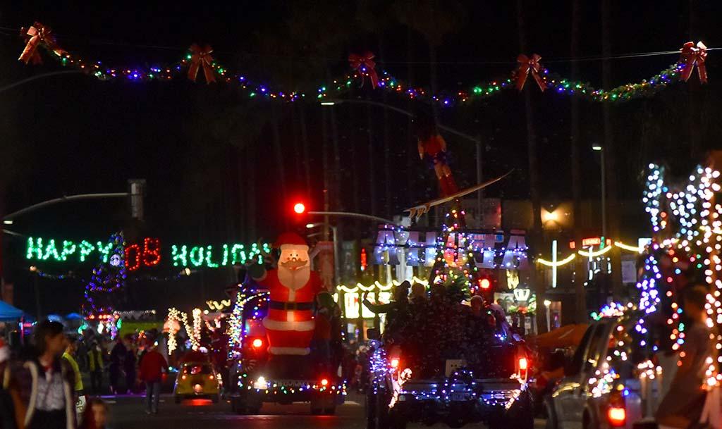 An inflated Santa makes its way down Newport Avenue toward the ocean.