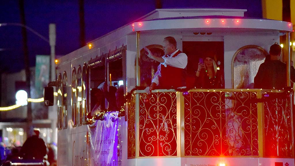 San Diego Mayor Kevin Faulconer waves from a trolley during the Ocean Beach Holiday Parade.