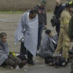 Rescued migrants wrapped in blankets