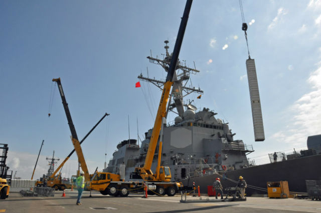 Missile canister is loaded onto a destroyer at Seal Beach