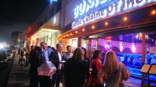 Crowd outside a Hillcrest restaurant