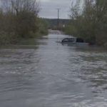 Pickup truck caught in flooded road